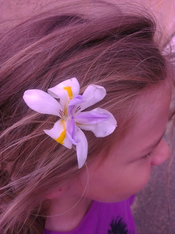 My gorgeous little six year old niece, Nay, loves wearing flowers in her hair just like me x